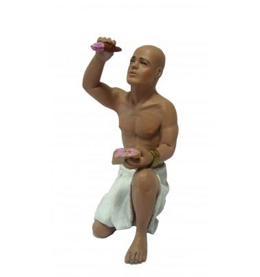 Egipcio pintando arrodillado