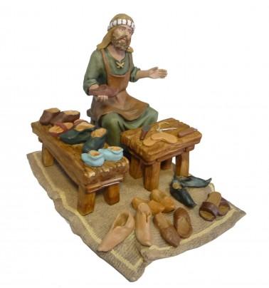 Conjunto zapatero con mesas y manta
