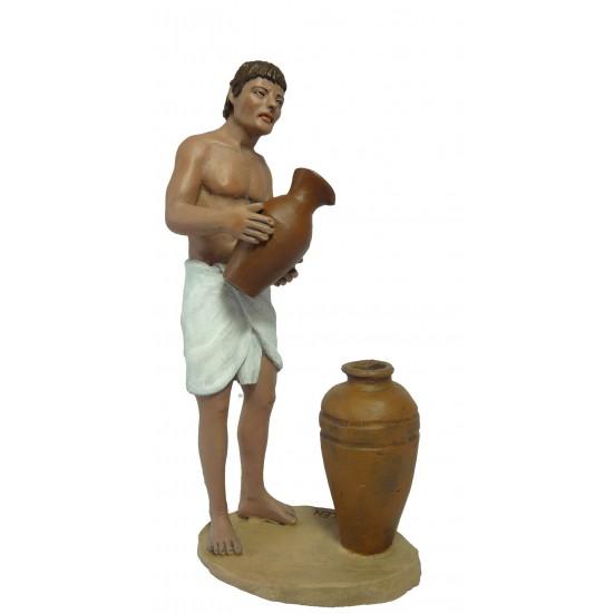 Egipcio vaciando aceite