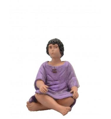 Niño sentado pies cruzados