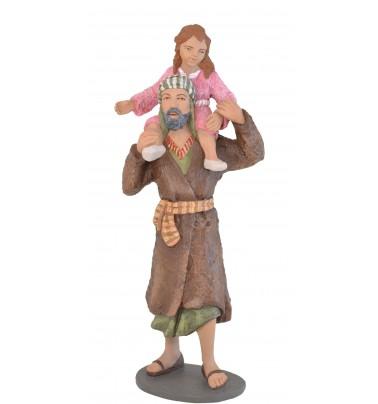 Pastor con niña al hombro