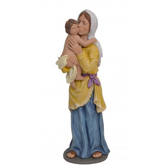 Pastora con niño en brazos