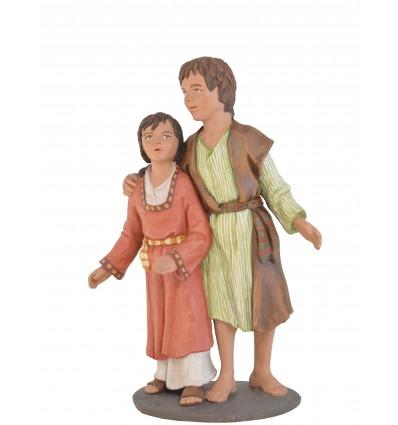 Grupo niño-niña - Fabricado en pasta cerámica Italiana.